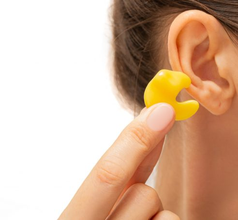 earplugs for noisy places, personally molded earplugs on ear close-up
